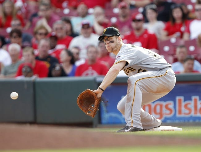 Sep 28, 2013; Cincinnati, OH, USA; Pittsburgh Pirates first baseman Justin Morneau (66) makes a play during the eighth inning against the Cincinnati Reds at Great American Ball Park. The Pirates defeated the Reds 8-3. Mandatory Credit: Frank Victores-USA TODAY Sports