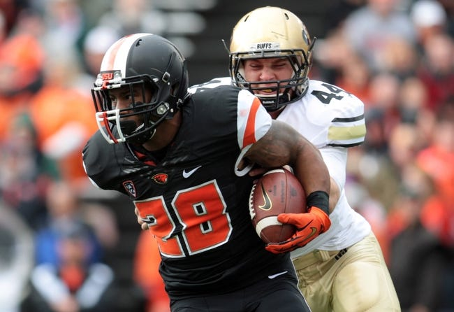 Sep 28, 2013; Corvallis, OR, USA; Colorado Buffaloes linebacker Addison Gillam (44) reaches for Oregon State Beavers running back Terron Ward (28) at Reser Stadium. Mandatory Credit: Scott Olmos-USA TODAY Sports