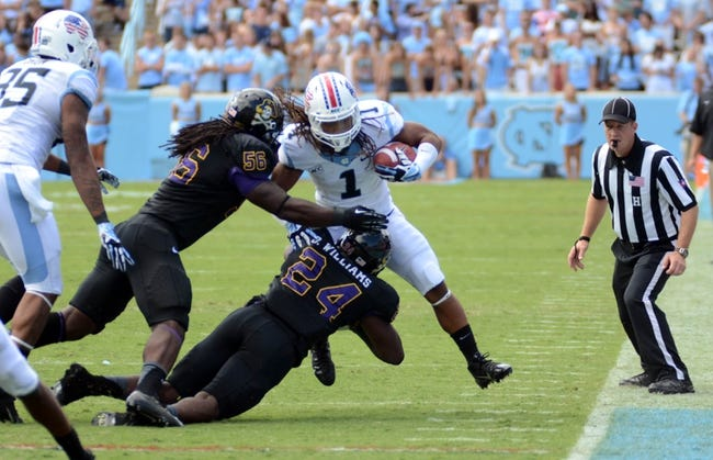 Sep 28, 2013; Chapel Hill, NC, USA; North Carolina Tarheels running back Khris Francis (1) is tackled by East Carolina Pirates linebacker Brandon Williams (24) during the second half at Kenan Memorial Stadium.  ECU won 55-31. Mandatory Credit: Rob Kinnan-USA TODAY Sports