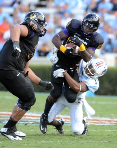 Sep 28, 2013; Chapel Hill, NC, USA; East Carolina Pirates running back Chris Hairston (22) is tackled by North Carolina Tarheels cornerback Malik Simmons (11) during the second half at Kenan Memorial Stadium.  ECU won 55-31. Mandatory Credit: Rob Kinnan-USA TODAY Sports