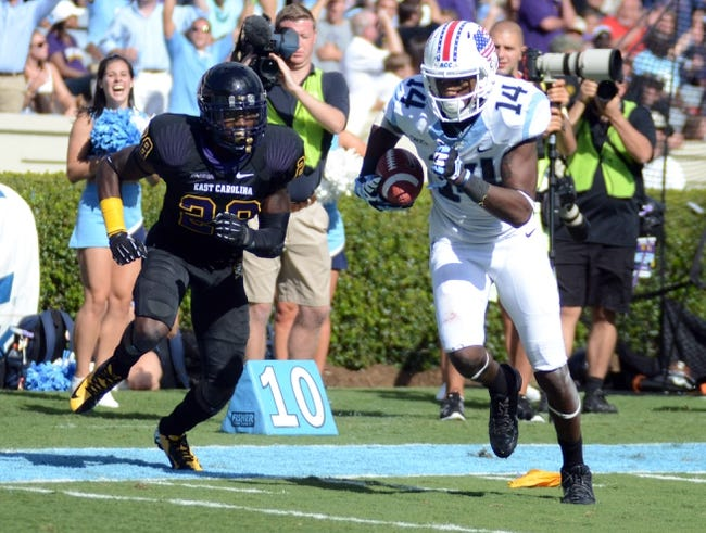 Sep 28, 2013; Chapel Hill, NC, USA; North Carolina Tarheels receiver Quinshad Davis (14) runs for a touchdown as East Carolina Pirates defensive back Josh Hawkins (28) pursues during the second half at Kenan Memorial Stadium.  ECU won 55-31. Mandatory Credit: Rob Kinnan-USA TODAY Sports