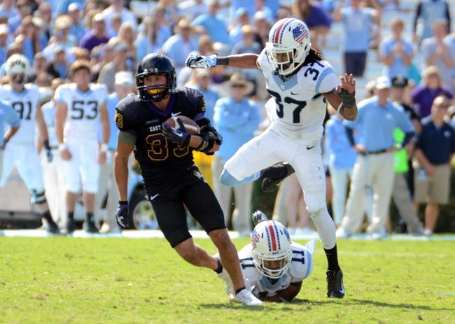 Sep 28, 2013; Chapel Hill, NC, USA; East Carolina Pirates receiver Danny Webster (33) breaks the tackle of defensive back Malik Simmons (11) after a second half reception at Kenan Memorial Stadium.  ECU won 55-31. Mandatory Credit: Rob Kinnan-USA TODAY Sports