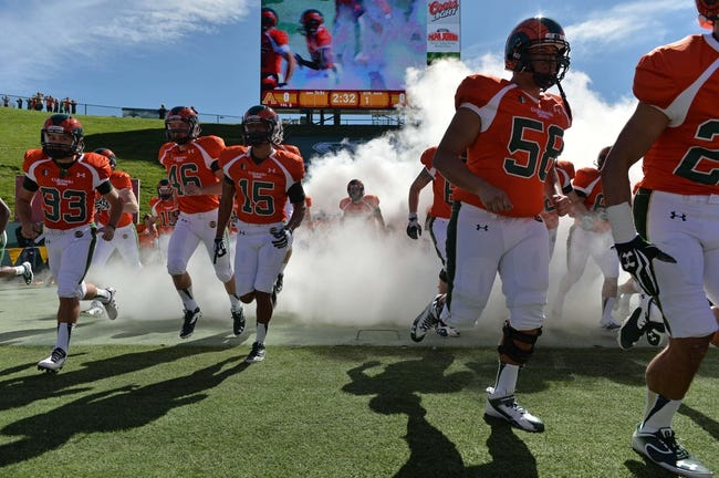 Sep 28, 2013; Fort Collins, CO, USA; Members of the Colorado State Rams run out to the field before the start of the game against the UTEP Miners at Hughes Stadium. Mandatory Credit: Ron Chenoy-USA TODAY Sports
