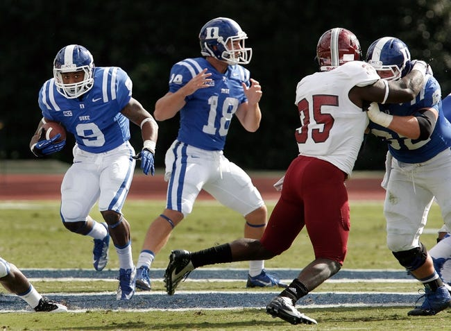 Sep 28, 2013; Durham, NC, USA;  Duke Blue Devils running back Josh Snead (9) runs the ball against the Troy Trojans at Wallace Wade Stadium. Mandatory Credit: Mark Dolejs-USA TODAY Sports