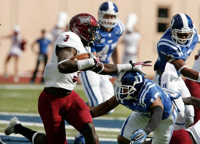 Sep 28, 2013; Durham, NC, USA;  Troy Trojans wide receiver Eric Thomas (3) runs the ball against Duke Blue Devils safety Jeremy Cash (16) at Wallace Wade Stadium. Mandatory Credit: Mark Dolejs-USA TODAY Sports