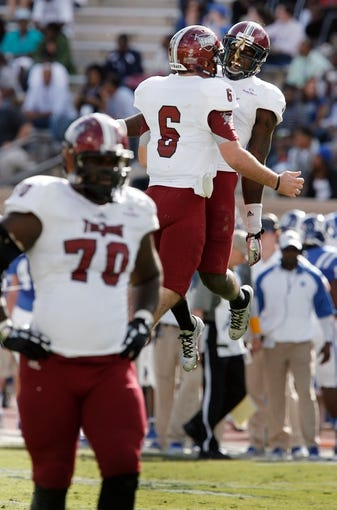 Sep 28, 2013; Durham, NC, USA;  Troy Trojans quarterback Corey Robinson (6) and wide receiver Eric Thomas (3) celebrate after a touchdown against the Duke Blue Devils at Wallace Wade Stadium. Mandatory Credit: Mark Dolejs-USA TODAY Sports