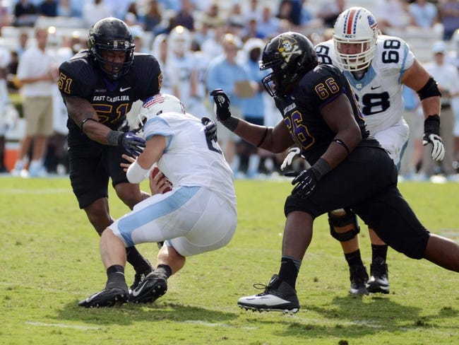 Sep 28, 2013; Chapel Hill, NC, USA; North Carolina Tarheels quarterback Bryn Renner (2) is sacked by East Carolina Pirates linebacker Montese Overton (51) and nose tackle Terrell Stanley (66) during the second half at Kenan Memorial Stadium.  ECU won 55-31. Mandatory Credit: Rob Kinnan-USA TODAY Sports