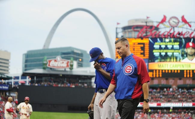 Sep 28, 2013; St. Louis, MO, USA; Chicago Cubs starting pitcher Edwin Jackson (36) is removed from the game with an injury during the third inning against the St. Louis Cardinals at Busch Stadium. Mandatory Credit: Jeff Curry-USA TODAY Sports