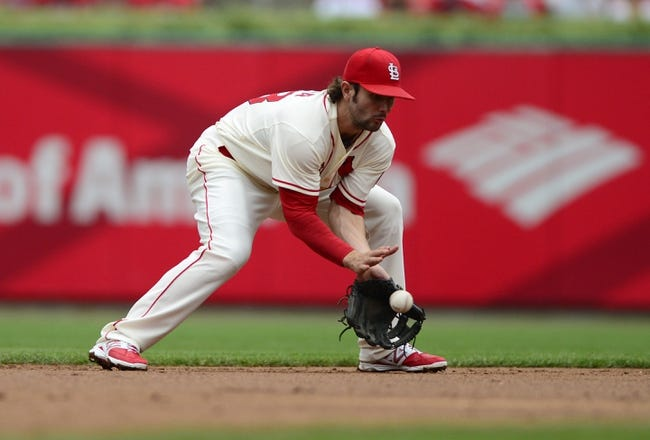 Sep 28, 2013; St. Louis, MO, USA; St. Louis Cardinals shortstop Pete Kozma (38) fields a ground ball hit by Chicago Cubs right fielder Nate Schierholtz (not pictured) during the second inning at Busch Stadium. Mandatory Credit: Jeff Curry-USA TODAY Sports