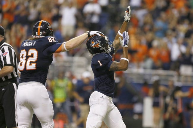 Sep 28, 2013; San Antonio, TX, USA; Texas-San Antonio Roadrunners wide receiver Kam Jones (1) is congratulated by tight end David Morgan(82) after scoring a touchdown against the Houston Cougars during the first half at Alamodome. Mandatory Credit: Soobum Im-USA TODAY Sports