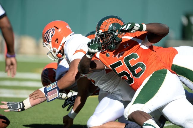 Sep 28, 2013; Fort Collins, CO, USA; Colorado State Rams linebacker Shaquil Barrett (56) goes after a fumble lost by UTEP Miners quarterback Jameill Showers (1) in the end zone late in the third quarter at Hughes Stadium. Mandatory Credit: Ron Chenoy-USA TODAY Sports