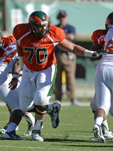 Sep 28, 2013; Fort Collins, CO, USA; Colorado State Rams offensive linesman Weston Richburg (70) pass protects against the UTEP Miners in the third quarter at Hughes Stadium. Mandatory Credit: Ron Chenoy-USA TODAY Sports