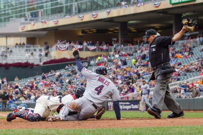 Sep 28, 2013; Minneapolis, MN, USA; Cleveland Indians third baseman Mike Aviles (4) is called safe at home by home plate umpire Larry Vanover in the fifth inning as Minnesota Twins catcher Eric Fryer (54) applies the tag at Target Field. Mandatory Credit: Brad Rempel-USA TODAY Sports