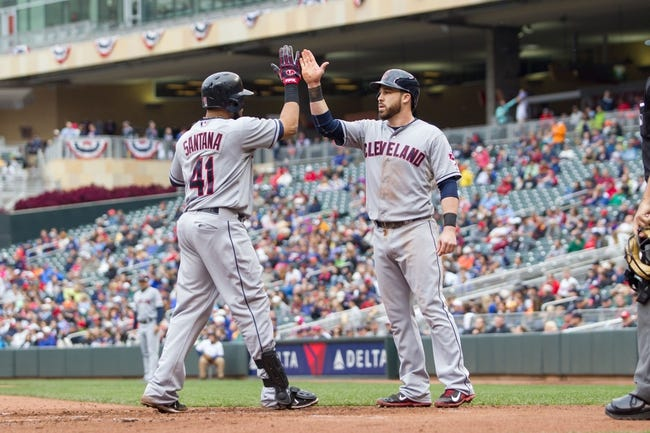 Sep 28, 2013; Minneapolis, MN, USA; Cleveland Indians catcher Carlos Santana (41) gets congratulated by second baseman Jason Kipnis (22) after his home run in the fourth inning against the Minnesota Twins at Target Field. Mandatory Credit: Brad Rempel-USA TODAY Sports