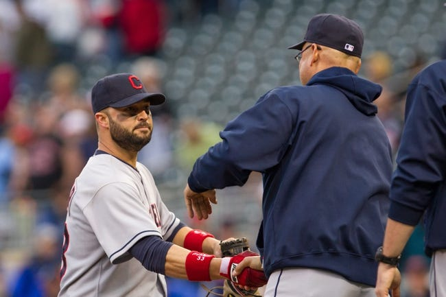 Sep 28, 2013; Minneapolis, MN, USA; Cleveland Indians first baseman Nick Swisher (33) gets a handshake from manager Terry Francona after their win against the Minnesota Twins  at Target Field. Mandatory Credit: Brad Rempel-USA TODAY SportsThe Cleveland Indians won 5-1.