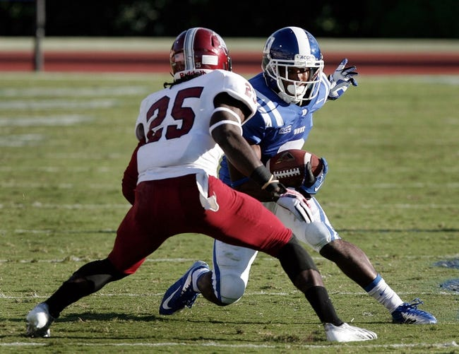 Sep 28, 2013; Durham, NC, USA;  Troy Trojans cornerback Chris Davis (25) defends as Duke Blue Devils wide receiver Jamison Crowder (3) runs the ball at Wallace Wade Stadium. Mandatory Credit: Mark Dolejs-USA TODAY Sports