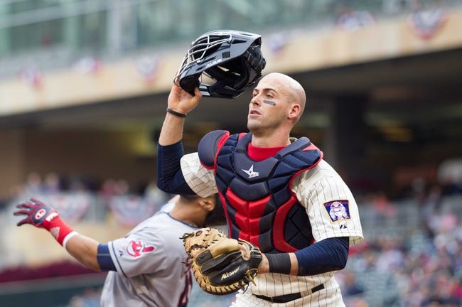 Sep 28, 2013; Minneapolis, MN, USA; Minnesota Twins catcher Eric Fryer (54) tracks down a foul ball in the fifth inning against the Cleveland Indians at Target Field. Mandatory Credit: Brad Rempel-USA TODAY SportsThe Cleveland Indians won 5-1.