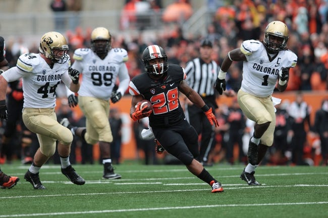 Sep 28, 2013; Corvallis, OR, USA; Oregon State Beavers running back Terron Ward (28) runs the ball against the Colorado Buffaloes at Reser Stadium. Mandatory Credit: Scott Olmos-USA TODAY Sports
