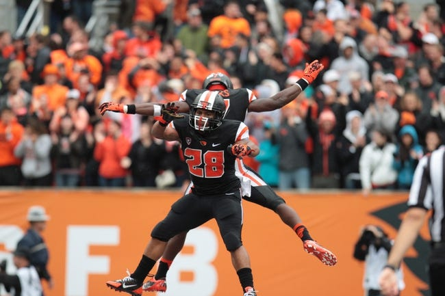Sep 28, 2013; Corvallis, OR, USA; Oregon State Beavers running back Terron Ward (28) celebrates with wide receiver Brandin Cooks (7) after a touchdown against the Colorado Buffaloes at Reser Stadium. Mandatory Credit: Scott Olmos-USA TODAY Sports