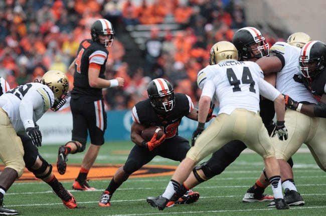 Sep 28, 2013; Corvallis, OR, USA; Oregon State Beavers quarterback Sean Mannion (4) hands the ball off to running back Terron Ward (28) against the Colorado Buffaloes at Reser Stadium. Mandatory Credit: Scott Olmos-USA TODAY Sports