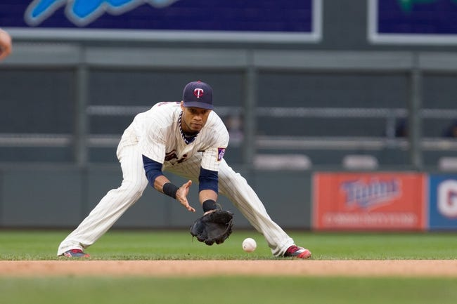 Sep 28, 2013; Minneapolis, MN, USA; Minnesota Twins shortstop Pedro Florimon (25) fields a ground ball in the sixth inning against the Cleveland Indians at Target Field. Mandatory Credit: Brad Rempel-USA TODAY SportsThe Cleveland Indians won 5-1.