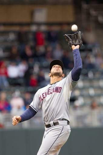Sep 28, 2013; Minneapolis, MN, USA; Cleveland Indians infielder Mike Aviles (4) catches the pop fly in the eighth inning against the Minnesota Twins at Target Field. Mandatory Credit: Brad Rempel-USA TODAY Sports