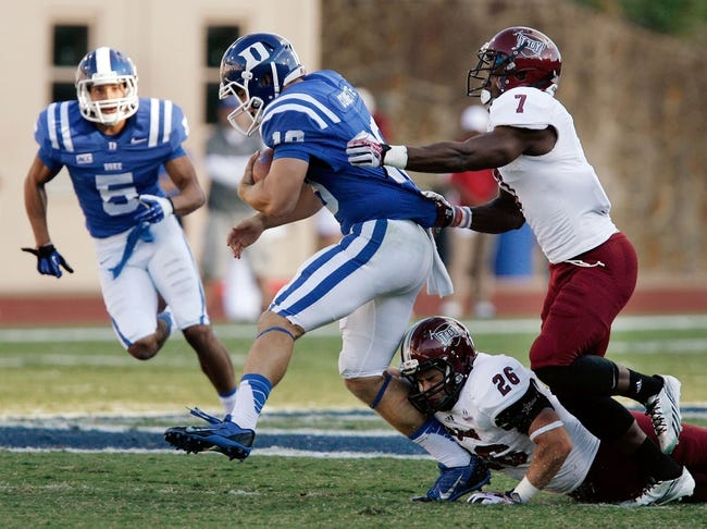 Sep 28, 2013; Durham, NC, USA;  Troy Trojans linebacker Mitchell Roland (26) and safety Chris Pickett (7) tackle Duke Blue Devils quarterback Brandon Connette (18) at Wallace Wade Stadium. Mandatory Credit: Mark Dolejs-USA TODAY Sports