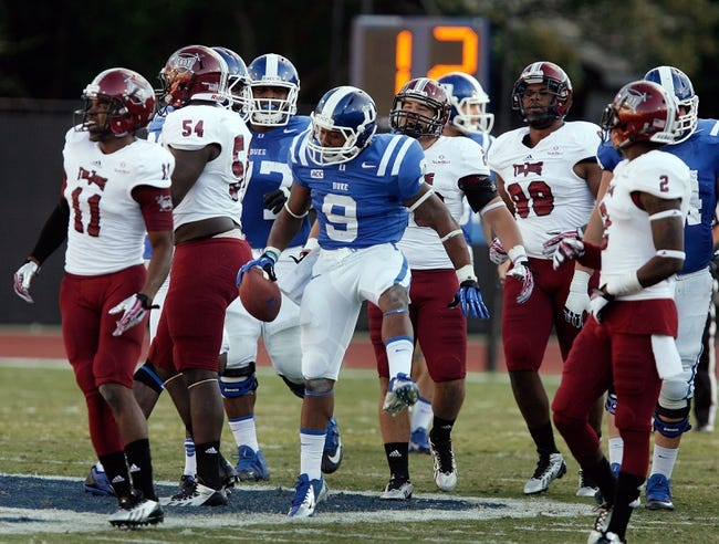 Sep 28, 2013; Durham, NC, USA;  Duke Blue Devils running back Josh Snead (9) celebrates a big gain against  the Troy Trojans at Wallace Wade Stadium. Mandatory Credit: Mark Dolejs-USA TODAY Sports