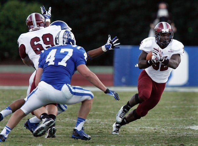 Sep 28, 2013; Durham, NC, USA;  Duke Blue Devils linebacker David Helton (47) defends as Troy Trojans running back Brandon Burks (32) runs the ball at Wallace Wade Stadium. Mandatory Credit: Mark Dolejs-USA TODAY Sports