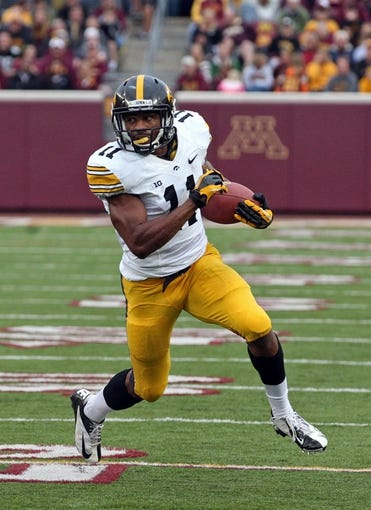 Sep 28, 2013; Minneapolis, MN, USA; Iowa Hawkeyes wide receiver Kevonte Martin-Manley (11) runs with the ball after making a catch in the second half against the Minnesota Golden Gophers at TCF Bank Stadium. The Hawkeyes won 23-7. Mandatory Credit: Jesse Johnson-USA TODAY Sports