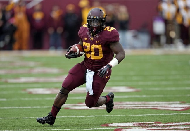 Sep 28, 2013; Minneapolis, MN, USA; Minnesota Golden Gophers running back Donnell Kirkwood (20) runs with the ball in the second half against the Iowa Hawkeyes at TCF Bank Stadium. The Hawkeyes won 23-7. Mandatory Credit: Jesse Johnson-USA TODAY Sports