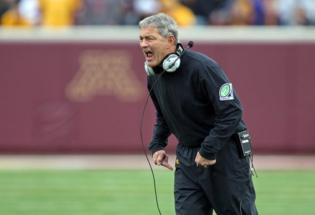 Sep 28, 2013; Minneapolis, MN, USA; Iowa Hawkeyes head coach Kirk Ferentz yells out to his players in the second half against the Minnesota Golden Gophers at TCF Bank Stadium. The Hawkeyes won 23-7. Mandatory Credit: Jesse Johnson-USA TODAY Sports