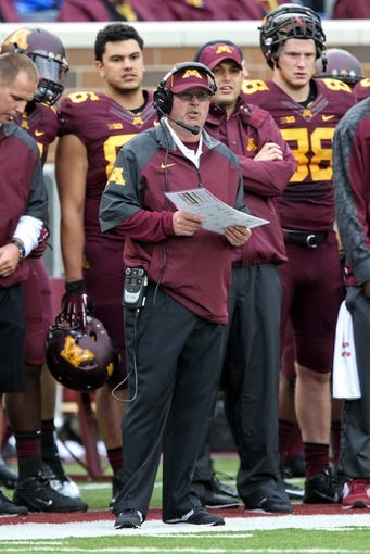 Sep 28, 2013; Minneapolis, MN, USA; Minnesota Golden Gophers head coach Jerry Kill looks on during the second half against the Iowa Hawkeyes at TCF Bank Stadium. The Hawkeyes won 23-7. Mandatory Credit: Jesse Johnson-USA TODAY Sports