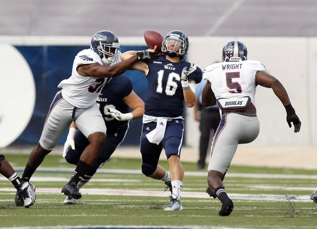Sep 28, 2013; Houston, TX, USA; Rice Owls quarterback Taylor McHargue (16) has the ball knocked loose by Florida Atlantic Owls defensive lineman Cory Henry (31) during the first half at Rice Stadium. Mandatory Credit: Andrew Richardson-USA TODAY Sports