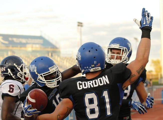 Sep 28, 2013; Buffalo, NY, USA; Buffalo Bulls wide receiver Fred Lee (18) celebrates his touchdown against the Connecticut Huskies with tight end Jimmy Gordon (81) during the second half at University of Buffalo Stadium. Buffalo beat Connecticut 41-12. Mandatory Credit: Kevin Hoffman-USA TODAY Sports