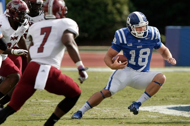 Sep 28, 2013; Durham, NC, USA; Duke Blue Devils quarterback Brandon Connette (18) scrambles in the backfield against the Troy Trojans at Wallace Wade Stadium. Mandatory Credit: Mark Dolejs-USA TODAY Sports