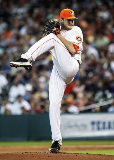 Sep 28, 2013; Houston, TX, USA; Houston Astros relief pitcher Paul Clemens (56) pitches during the first inning against the New York Yankees at Minute Maid Park. Mandatory Credit: Troy Taormina-USA TODAY Sports