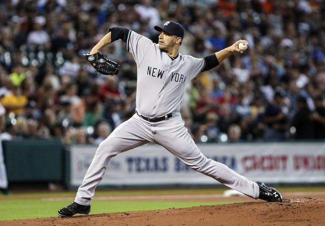 Sep 28, 2013; Houston, TX, USA; New York Yankees starting pitcher Andy Pettitte (46) pitches during the first inning against the Houston Astros at Minute Maid Park. Mandatory Credit: Troy Taormina-USA TODAY Sports