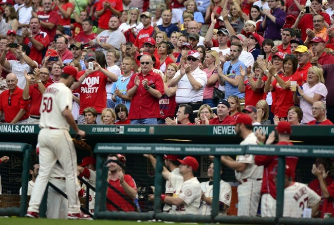 Sep 28, 2013; St. Louis, MO, USA; St. Louis Cardinals starting pitcher Adam Wainwright (50) walks off the field as fan cheer for him during the sixth inning at Busch Stadium. St. Louis defeated Chicago 6-2. Mandatory Credit: Jeff Curry-USA TODAY Sports