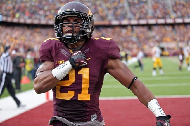 Sep 28, 2013; Minneapolis, MN, USA; Minnesota Golden Gophers defensive back Brock Vereen (21) celebrates after intercepting a pass in the second half against the Iowa Hawkeyes at TCF Bank Stadium. The Hawkeyes won 23-7. Mandatory Credit: Jesse Johnson-USA TODAY Sports