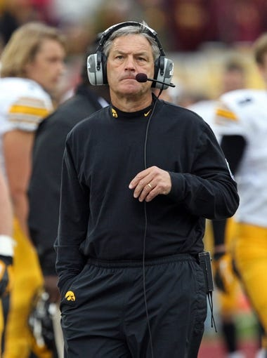 Sep 28, 2013; Minneapolis, MN, USA; Iowa Hawkeyes head coach Kirk Ferentz looks on during the second half against the Minnesota Golden Gophers at TCF Bank Stadium. The Hawkeyes won 23-7. Mandatory Credit: Jesse Johnson-USA TODAY Sports
