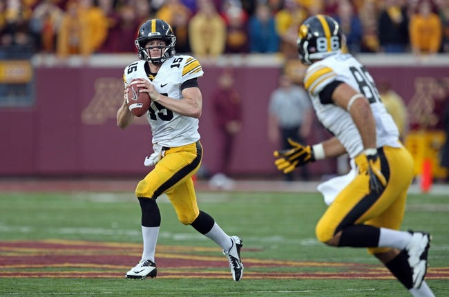 Sep 28, 2013; Minneapolis, MN, USA; Iowa Hawkeyes quarterback Jake Rudock (15) looks to pass the ball to tight end C.J. Fiedorowicz (86) in the second half against the Minnesota Golden Gophers at TCF Bank Stadium. The Hawkeyes won 23-7. Mandatory Credit: Jesse Johnson-USA TODAY Sports