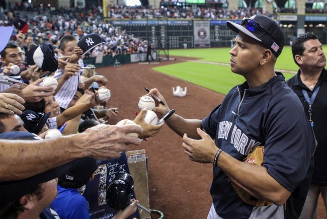 Sep 28, 2013; Houston, TX, USA; New York Yankees third baseman Alex Rodriguez (13) signs autographs before a game against the Houston Astros at Minute Maid Park. Mandatory Credit: Troy Taormina-USA TODAY Sports