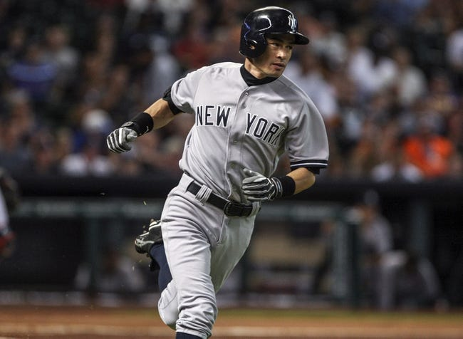 Sep 28, 2013; Houston, TX, USA; New York Yankees designated hitter Ichiro Suzuki (31) gets a hit during the second inning against the Houston Astros at Minute Maid Park. Mandatory Credit: Troy Taormina-USA TODAY Sports