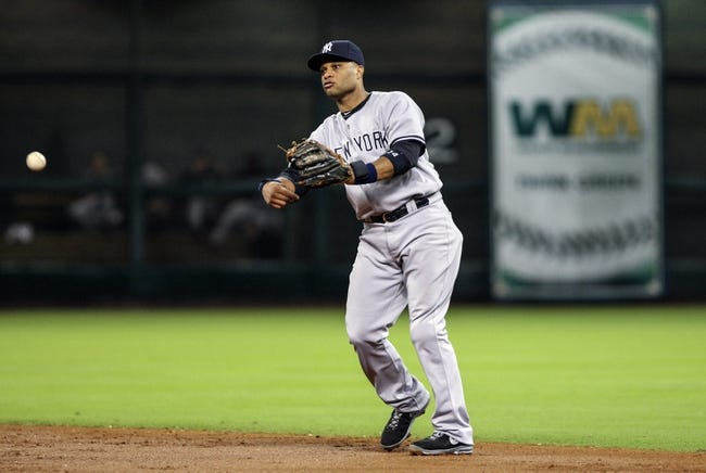 Sep 28, 2013; Houston, TX, USA; New York Yankees second baseman Robinson Cano (24) throws to first base during the second inning against the Houston Astros at Minute Maid Park. Mandatory Credit: Troy Taormina-USA TODAY Sports