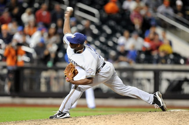 Sep 28, 2013; New York, NY, USA; Milwaukee Brewers relief pitcher Alfredo Figaro (45) throws a pitch against the New York Mets during the tenth inning at Citi Field. The Brewers won the game 4-2. Mandatory Credit- Joe Camporeale-USA TODAY Sports