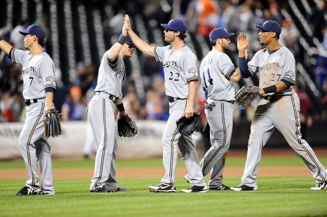 Sep 28, 2013; New York, NY, USA; The Milwaukee Brewers celebrate a win over the New York Mets after the tenth inning at Citi Field. The Brewers won the game 4-2. Mandatory Credit- Joe Camporeale-USA TODAY Sports