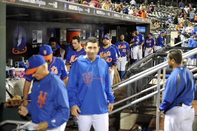 Sep 28, 2013; New York, NY, USA; New York Mets players and coaches leave the dugout after losing to the Milwaukee Brewers at Citi Field. The Brewers won the game 4-2. Mandatory Credit- Joe Camporeale-USA TODAY Sports