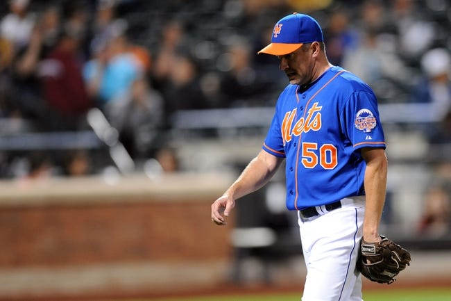 Sep 28, 2013; New York, NY, USA; New York Mets relief pitcher Scott Atchison (50) leaves the game against the Milwaukee Brewers during the tenth inning at Citi Field. The Brewers won the game 4-2. Mandatory Credit- Joe Camporeale-USA TODAY Sports