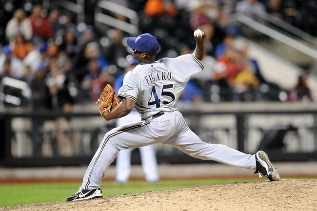 Sep 28, 2013; New York, NY, USA; Milwaukee Brewers relief pitcher Alfredo Figaro (45) throws a pitch during the tenth inning against the New York Mets at Citi Field. The Brewers won the game 4-2. Mandatory Credit- Joe Camporeale-USA TODAY Sports